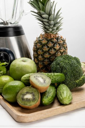 Photo for Blender near fresh fruits and organic raw vegetables on white - Royalty Free Image