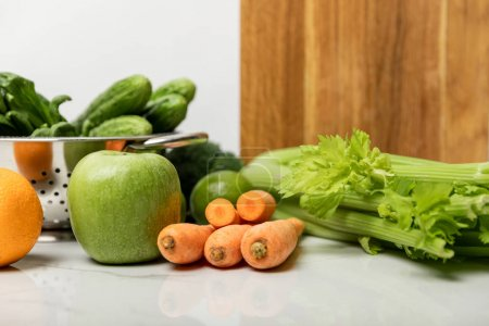 Foto de Tasty fruits near ripe, fresh vegetables and wooden cutting board on white - Imagen libre de derechos