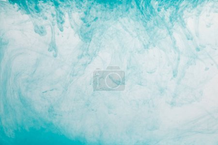Photo for Close up view of light blue paint swirls in water - Royalty Free Image