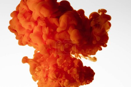 Close up view of orange watercolor splash isolated on white