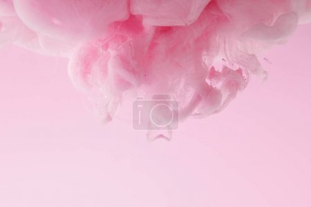 Photo for Close up view of pink paint swirls in water isolated on pink - Royalty Free Image