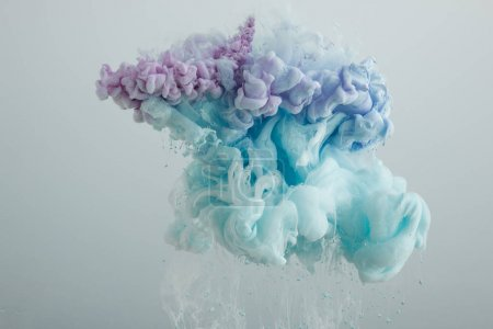 Photo for Close up view of light blue, pink and purple paint mixing isolated on grey - Royalty Free Image