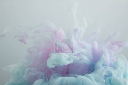 Photo for Close up view of light blue and pink paint swirls isolated on grey - Royalty Free Image