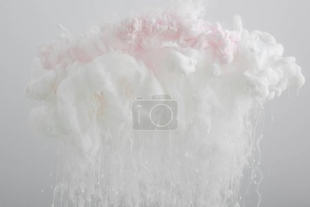 Photo for Close up view of acrylic light pink paint swirls isolated on grey - Royalty Free Image