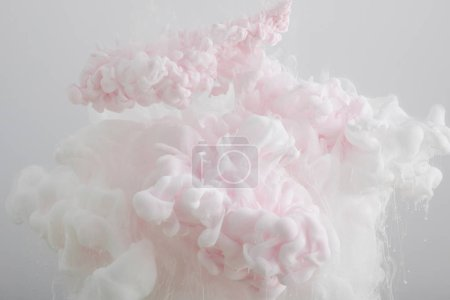 Photo for Close up view of light pink paint swirls isolated on grey - Royalty Free Image