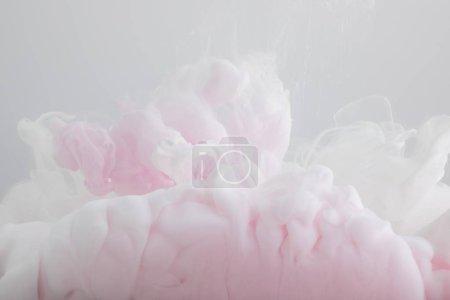 Photo for Close up view of light pink paint mixing isolated on grey - Royalty Free Image