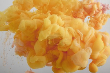 Photo for Close up view of acrylic orange paint swirls in water - Royalty Free Image