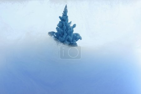 Photo for Close up view of blue paint splat in water - Royalty Free Image