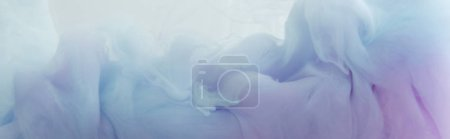 Photo for Close up view of light blue and purple paint swirls in water - Royalty Free Image