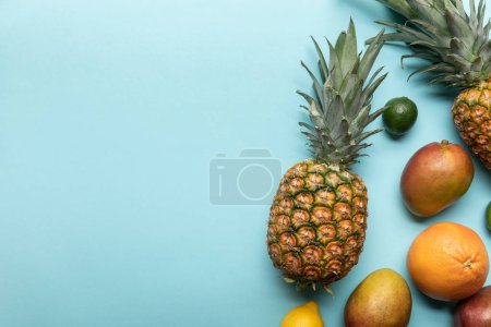 Photo for Top view of ripe exotic fresh fruits on blue background with copy space - Royalty Free Image