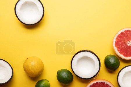 Photo for Top view of citrus fruits and coconuts on yellow background with copy space - Royalty Free Image
