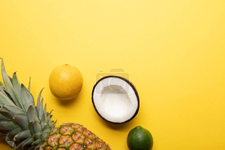 Photo for Top view of ripe organic tropical fruits on yellow background - Royalty Free Image