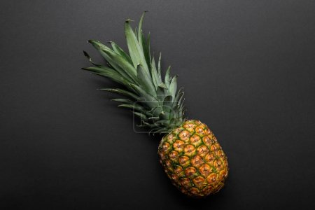 Photo for Top view of ripe yellow pineapple on black background - Royalty Free Image