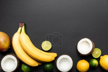 Photo for Top view of ripe tropical fruits on black background with copy space - Royalty Free Image