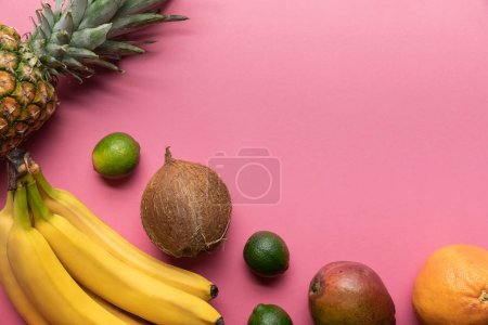 Photo for Top view of ripe tropical fruits on pink background with copy space - Royalty Free Image