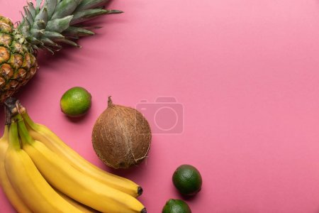 Photo for Top view of ripe tropical bright fruits on pink background with copy space - Royalty Free Image