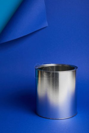 Photo for Metal shiny can on bright blue background with copy space - Royalty Free Image