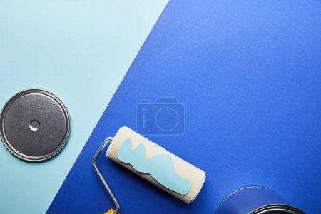 Photo for Top view of metal shiny cap and blue paper cut paint on roller - Royalty Free Image