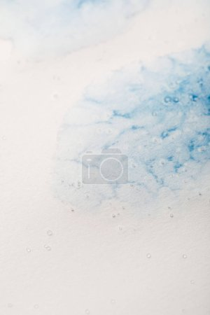 Photo for Blue watercolor paint spill on white textured background - Royalty Free Image