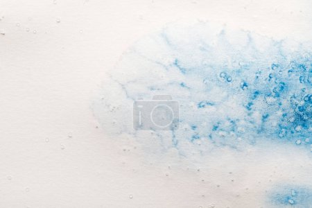 Photo for Blue watercolor paint spill on white background with copy space - Royalty Free Image