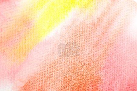 Foto de Close up view of yellow and red watercolor paint brushstrokes on white paper - Imagen libre de derechos