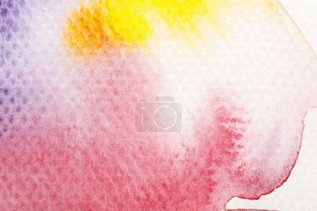 Photo for Top view of yellow, purple and red watercolor pale paint spills on white background - Royalty Free Image