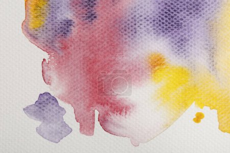 Photo for Top view of yellow, purple and red watercolor paint spills on paper background - Royalty Free Image