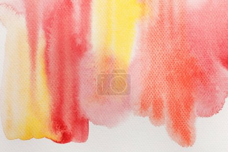 Photo for Close up view of pale yellow and red watercolor paint spills on white background - Royalty Free Image