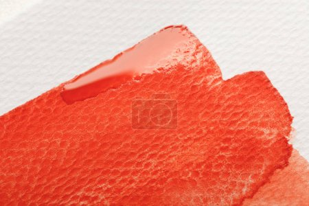 Photo for Close up view of red watercolor paint brushstroke on white background - Royalty Free Image