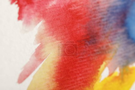 Photo pour Close up view of multicolored watercolor paint spills on white background - image libre de droit