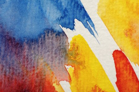 Foto de Close up view of yellow, blue and red watercolor paint brushstrokes on white background - Imagen libre de derechos