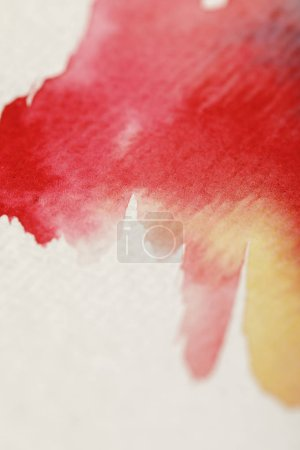 Photo for Close up view of yellow, blue and red watercolor paint spills on white background - Royalty Free Image