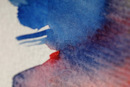 Photo for Close up view of blue and red watercolor paint spills on white background - Royalty Free Image