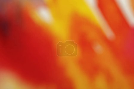 Photo for Close up view of yellow and red blurred watercolor paint spills - Royalty Free Image