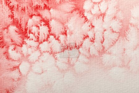 Photo for Close up view of red watercolor paint spill on white paper background - Royalty Free Image