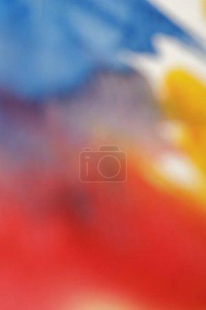 Foto de Close up view of blurred yellow, blue and red watercolor paint spills - Imagen libre de derechos