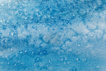 Photo for Close up view of blue watercolor paint on textured background - Royalty Free Image