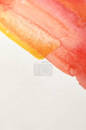 Photo for Close up view of yellow and red watercolor paints on white background with copy space - Royalty Free Image