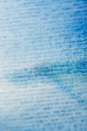 Photo for Close up view of blue watercolor paint on textured paper background - Royalty Free Image