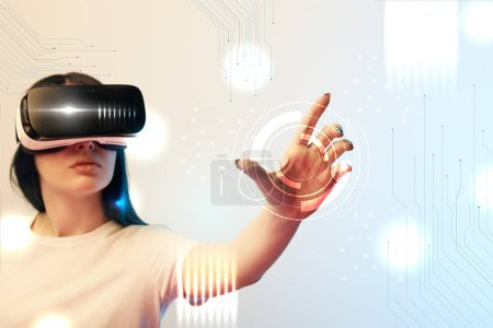 young woman in vr headset holding circle illustration on beige and blue background
