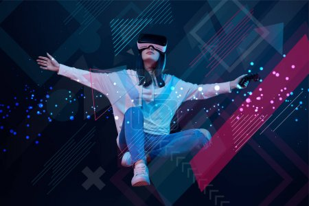 Photo for KYIV, UKRAINE - APRIL 5, 2019: Young woman in virtual reality headset with joystick flying in air among glowing data illustration on dark background - Royalty Free Image