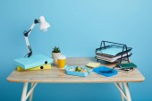 "Постер, картина, фотообои ""studio shot of workspace with table and lunch box on blue background"""
