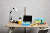 """Постер, картина, фотообои """"lunch box at workplace with laptop and papers on wooden table on white background, illustrative editorial"""""""
