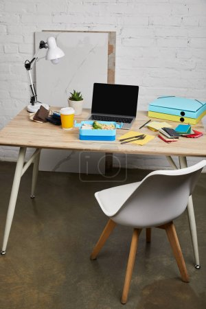 Foto de Workspace with lunch box with tasty food on wooden table on white background, illustrative editorial - Imagen libre de derechos