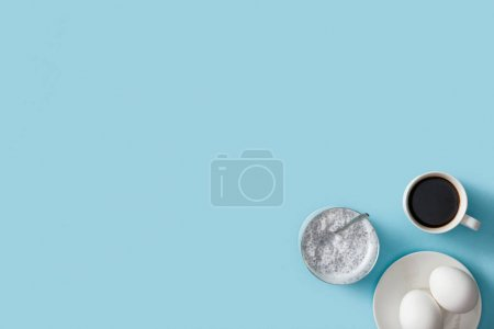 Photo for Top view of fresh eggs on white plate, yogurt with chia seeds and coffee - Royalty Free Image