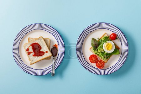 Photo for Top view of served breakfast, toasts with guacamole and jam on blue background - Royalty Free Image