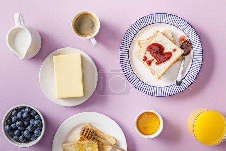 Photo for Top view of served breakfast on violet background - Royalty Free Image