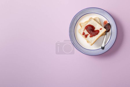 Photo for Top view of toasts with jam on violet background - Royalty Free Image