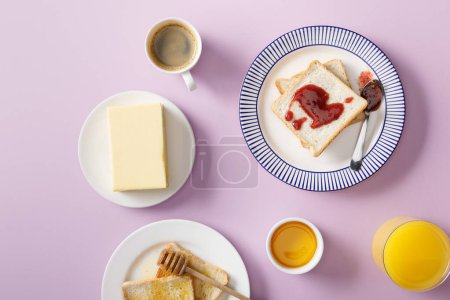 Photo for Top view of butter, coffee, orange juice, toasts with honey and jam on plates on violet background - Royalty Free Image