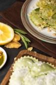 "Постер, картина, фотообои ""selective focus of green delicious ravioli with pine nuts on plate"""